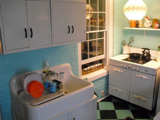 cute vintage appliances and sinks can add charm to a small kitchen