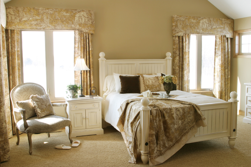 here i love the shades of ivory with french white furniture